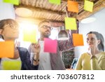 Stock photo business people meeting at office and use post it notes to share idea brainstorming concept 703607812