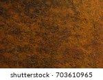 rusty metal | Shutterstock . vector #703610965