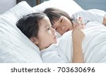 two little asian chinese girl... | Shutterstock . vector #703630696