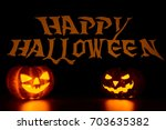 two pumpkin lanterns with faces ... | Shutterstock . vector #703635382