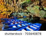 boat ride in diros caves  a... | Shutterstock . vector #703640878