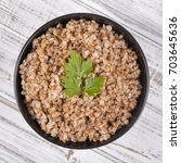 buckwheat porridge in black... | Shutterstock . vector #703645636
