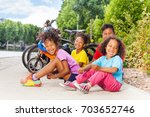 laughing african kids sitting... | Shutterstock . vector #703652746