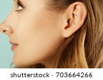 picture of female ear close up | Shutterstock . vector #703664266