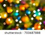 defocused ligths of christmas...   Shutterstock . vector #703687888