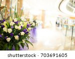 arrangement of flowers in the... | Shutterstock . vector #703691605
