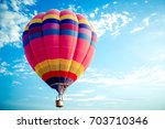 colorful hot air balloon flying ... | Shutterstock . vector #703710346