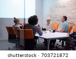 group of a young business... | Shutterstock . vector #703721872