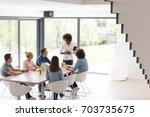 multiethnic startup business... | Shutterstock . vector #703735675