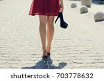 young beautiful lady in red... | Shutterstock . vector #703778632
