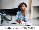 focused young african female... | Shutterstock . vector #703779808