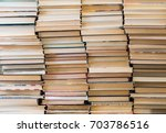 a stack of books with colorful... | Shutterstock . vector #703786516