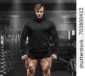 muscular man with muscle legs... | Shutterstock . vector #703800412