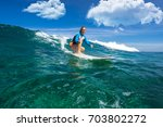 muscular surfer with long white ... | Shutterstock . vector #703802272