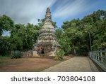 religious building on mountain... | Shutterstock . vector #703804108