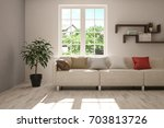 idea of white room with sofa... | Shutterstock . vector #703813726