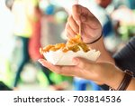 the food on the street is a...   Shutterstock . vector #703814536