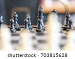 black chess pieces on a chess... | Shutterstock . vector #703815628