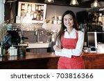 young asian women barista... | Shutterstock . vector #703816366