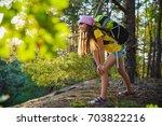 girl traveler with backpack in... | Shutterstock . vector #703822216