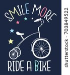 smile more ride a bike slogan... | Shutterstock .eps vector #703849522