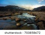 moraine park meadows at sunrise ... | Shutterstock . vector #703858672