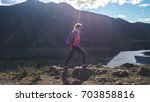 hiker with backpack hiking on...   Shutterstock . vector #703858816