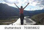 hiker woman standing on top of...   Shutterstock . vector #703858822