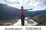 hiker slim woman standing on...   Shutterstock . vector #703858852