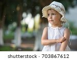 a girl stands on the street and ... | Shutterstock . vector #703867612