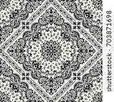 vector ornament paisley... | Shutterstock .eps vector #703871698