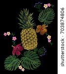 embroidered exotic yellow... | Shutterstock .eps vector #703874806