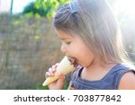 little girl eating ice cream... | Shutterstock . vector #703877842