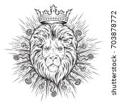 hand drawn crowned lion head in ... | Shutterstock .eps vector #703878772
