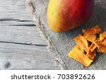 raw organic dried mango and... | Shutterstock . vector #703892626