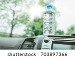 bottled water was left in the... | Shutterstock . vector #703897366
