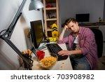indifferent teenage boy sitting ... | Shutterstock . vector #703908982