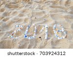 tropical beach with sand and... | Shutterstock . vector #703924312