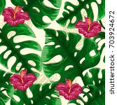 tropical seamless pattern with... | Shutterstock .eps vector #703924672