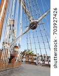 Small photo of Sailboat ropes pulley shroud blue sky clouds
