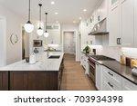 kitchen interior with island ... | Shutterstock . vector #703934398
