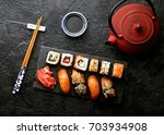 variation of sushi and rolls on ... | Shutterstock . vector #703934908