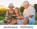child with grandparents  photo... | Shutterstock . vector #703943662