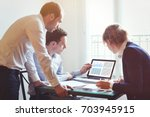 business people working on... | Shutterstock . vector #703945915