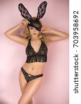 sexy girl with bunny ears over... | Shutterstock . vector #703958692