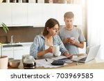 hard working female being busy... | Shutterstock . vector #703969585