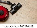 vacuum cleaner on floor ...   Shutterstock . vector #703970692