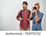 studio shot of astonished... | Shutterstock . vector #703970722