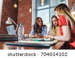 group of female coworkers... | Shutterstock . vector #704014102