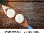 couple of man and woman holding ... | Shutterstock . vector #704014888